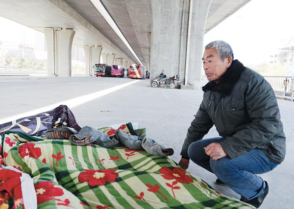 Migrant workers shelter beneath overpasses