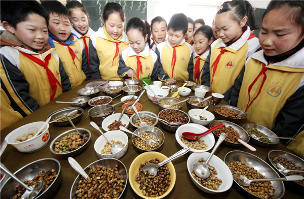Chinese enjoy longtaitou festival traditional food 1 for Academy of oriental cuisine
