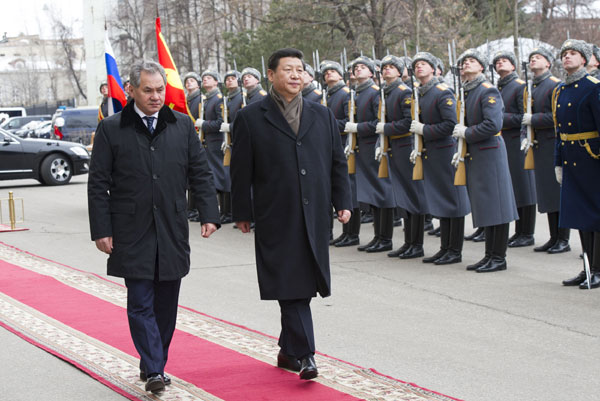 Xi hopes China, Russia to boost military ties