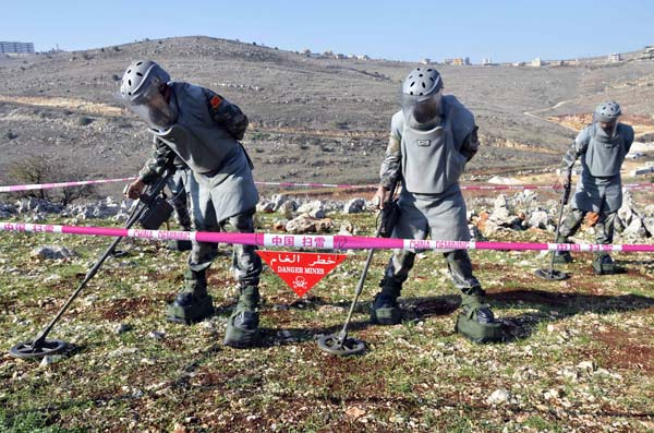 Chinese soldiers clear mines, win hearts