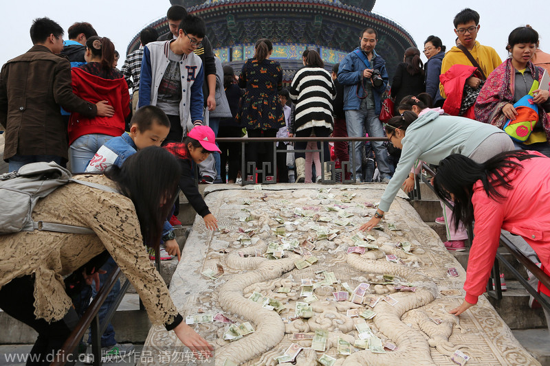 Visitors trade cash for luck at World Heritage site