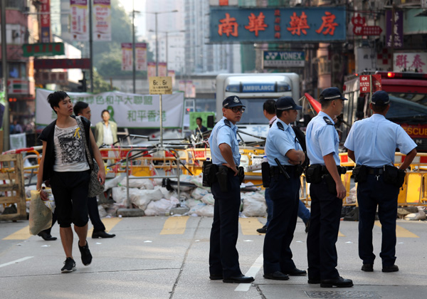 HK police vow minimum force to remove protest road barriers