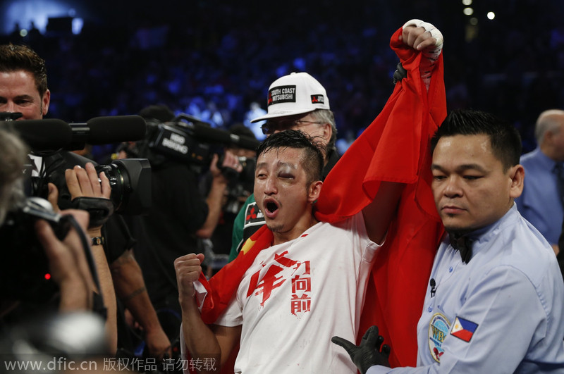 China's boxer Zou guaranteed shot at Amnat Ruenroeng in 2015