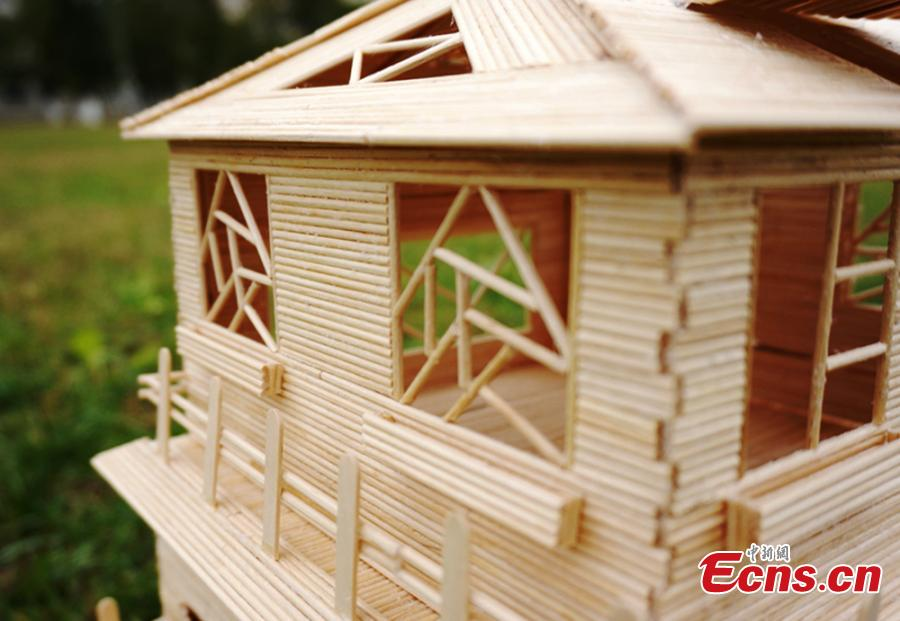 Students create 'villas' with small wooden sticks