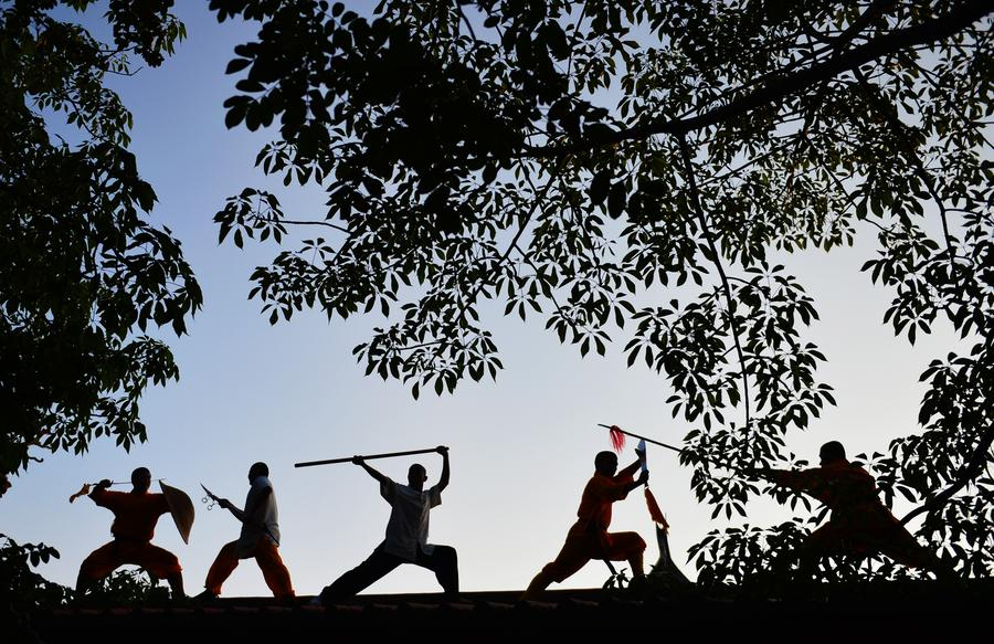 Monks practice martial art at Quanzhou Shaolin Temple