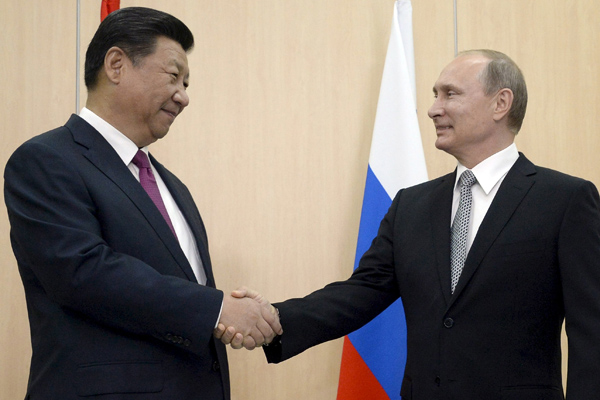 Xi, Putin agree to actions on connectivity proposals