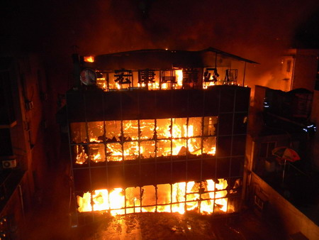 Death toll in building fire rises to nine