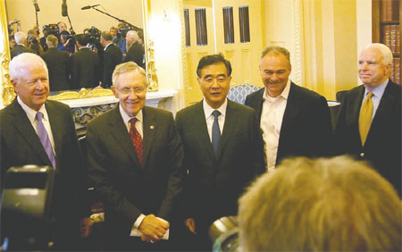 Wang, Yang make the rounds in DC