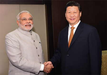 Xi meets with India's new PM