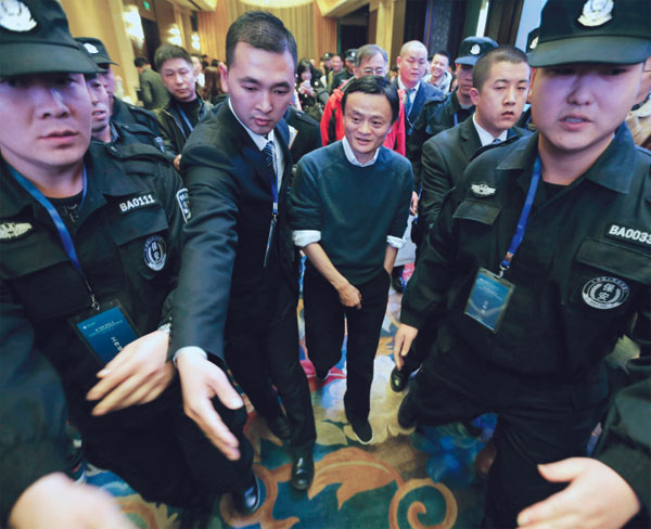 Alibaba Group Executive Chairman Jack Ma (center) leaves after the Fifth Conference of Zhejiang Chamber of Commerce in Beijing on Dec 6. Ma was awarded Honorary Chairman of Zhejiang Chamber of Commerce during the conference.