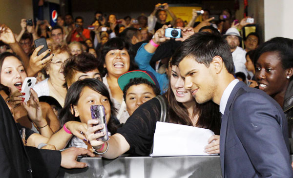 Taylor Lautner attends 'Abduction' world premiere