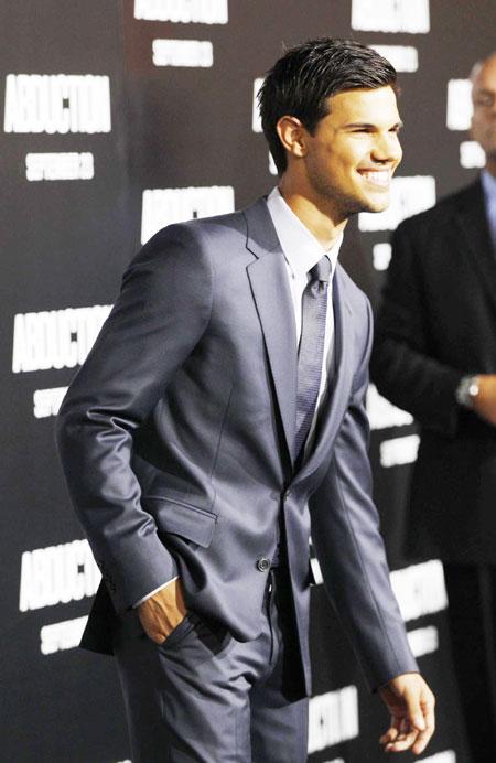 Taylor Lautner attends 'Abduction' world premiere