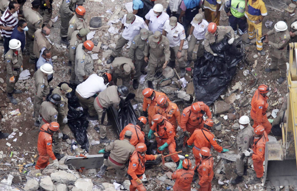 12 Dead 17 Missing In Rio Building Collapse Society