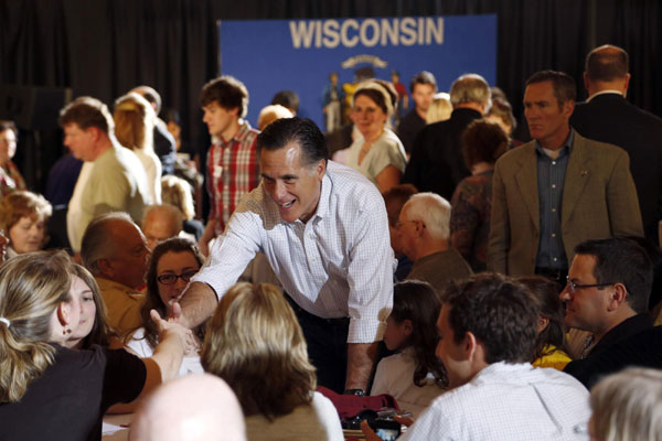 US Republican presidential candidate Mitt Romney greets supporters ...