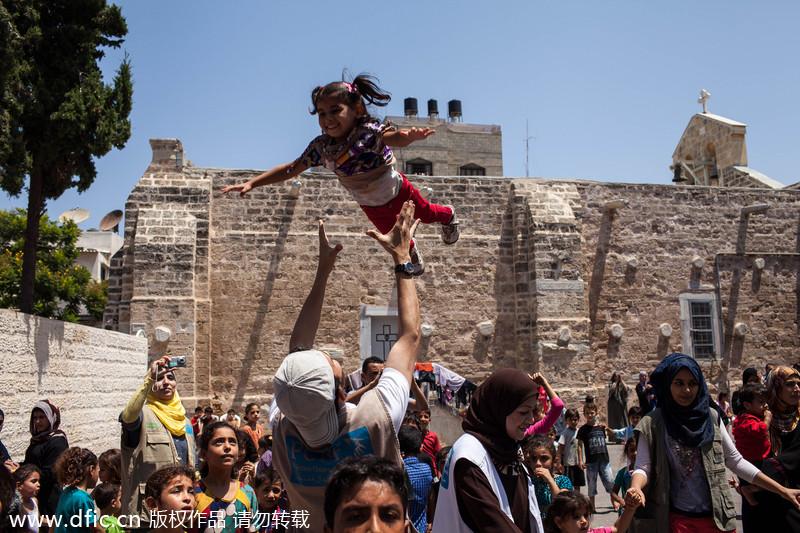 Great Gaza Eid Al-Fitr Feast - eca86bd9ddb415426efc07  Pictures_42360 .jpg